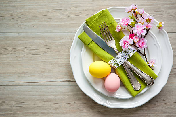 easter table setting with spring flowers and cutlery - easter brunch stock photos and pictures
