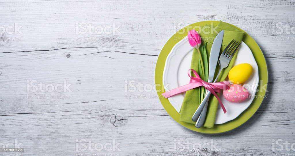 Easter table setting with spring flowers and cutlery stock photo
