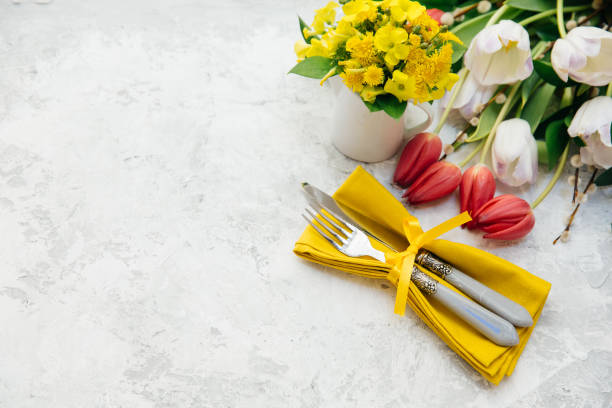 easter table setting with spring flowers and easter eggs - easter brunch stock photos and pictures