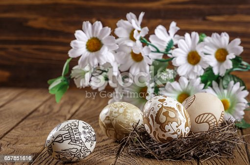 istock Easter theme. painted Easter egg on the wood background. Easter holidays, composition. 657851616