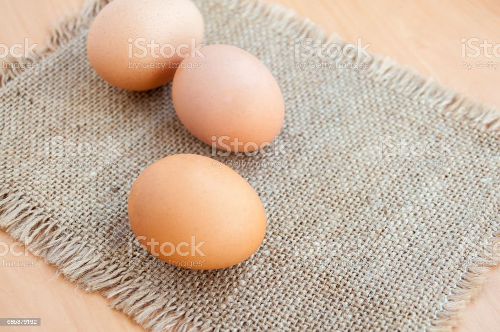 Easter three chicken eggs on a canvas napkin foto de stock royalty-free