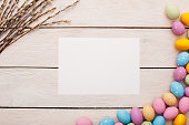 Easter traditional objects isolated on wooden background letter paper