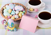 Blank envelope with Easter eggs, candy and coffee