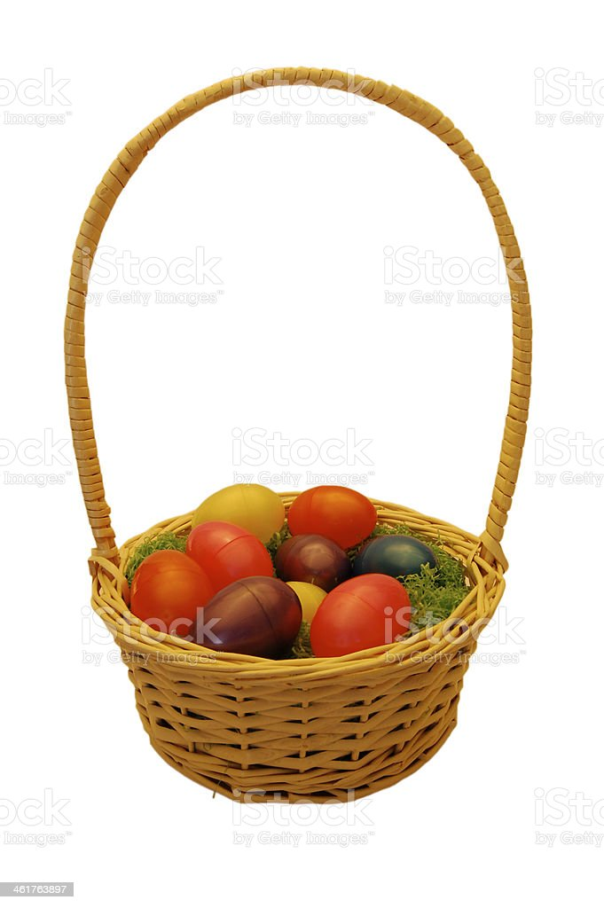 Easter wicker basket with colorful plastic eggs royalty-free stock photo