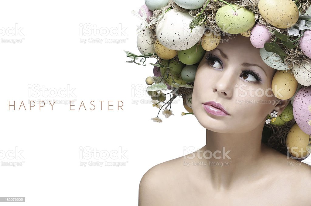 Easter Woman with Colorful Eggs. Spring Girl with Fashion Hairstyle stock photo
