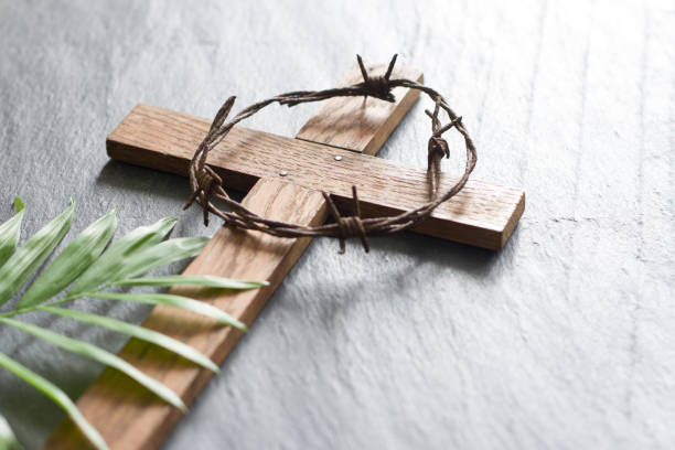 Easter wooden cross on black marble background religion abstract palm sunday concept stock photo
