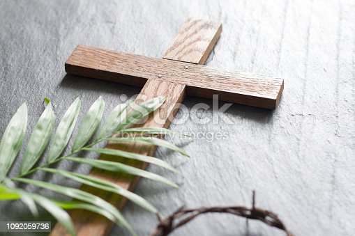 Easter wooden cross on black marble background religion abstract palm sunday concept closeup