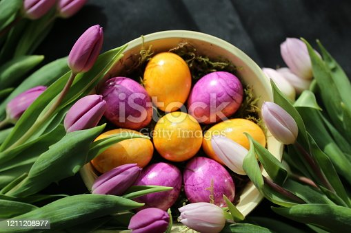 istock Easterdecoration with coloured eggs and flowers 1211208977