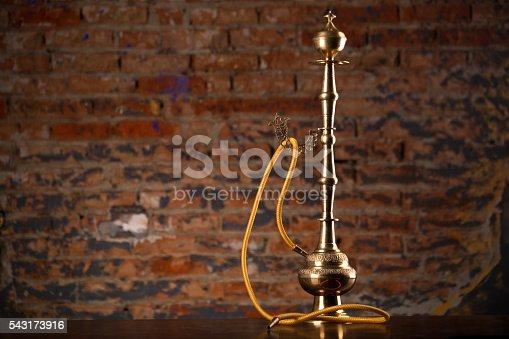 544347934 istock photo Eastern hookah on wood table 543173916
