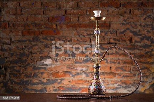 544347934 istock photo Eastern hookah on wood table 543174098