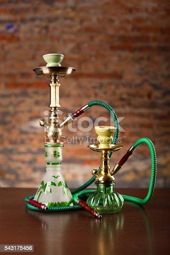 544347934 istock photo Eastern hookahs on wood table 543175456