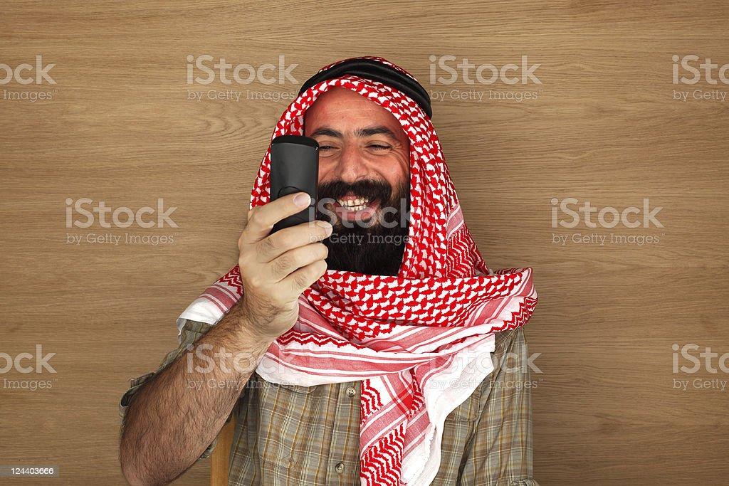 Eastern man looking phone royalty-free stock photo