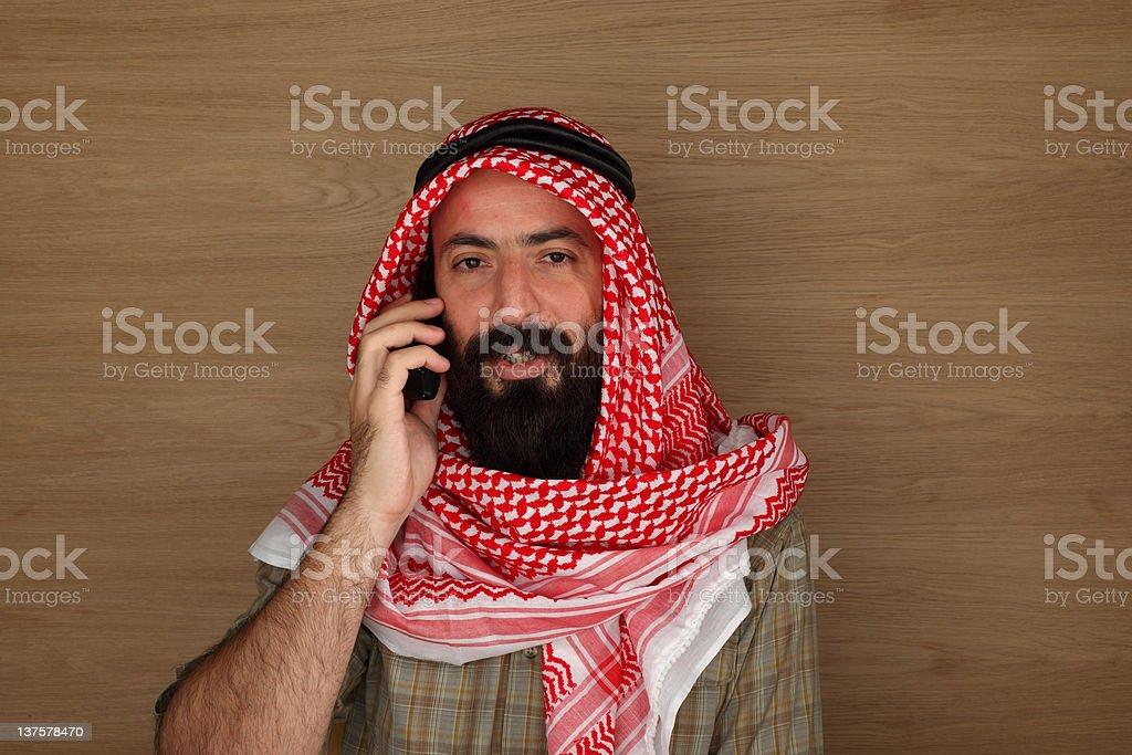 Eastern man talking on phone stock photo