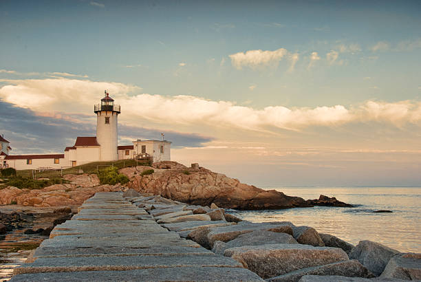 Eastern Point Lighthouse, Gloucester, Massachusetts Eastern Point Light is an historic lighthouse on Cape Ann, in northeastern Massachusetts. The lighthouse was originally planned in 1829 and was erected by 1832 on the east side of the Gloucester Harbor entrance. It was first lit on January 1, 1832. gloucester massachusetts stock pictures, royalty-free photos & images