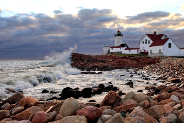 Eastern Point Lighthouse, Gloucester, Massachusetts Eastern Point Lighthouse is situated at the eastern tip of Massachusetts Gloucester Harbor.  The lighthouse is currently operated by the United States Coast Guard. gloucester massachusetts stock pictures, royalty-free photos & images