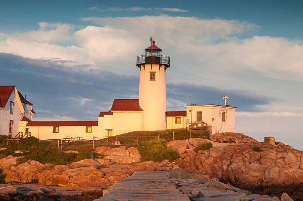 Eastern Point Lighthouse in Gloucester, Massachusetts Eastern Point Light is an historic lighthouse on Cape Ann, in northeastern Massachusetts. The lighthouse was originally planned in 1829 and was erected by 1832 on the east side of the Gloucester Harbor entrance. It was first lit on January 1, 1832. gloucester massachusetts stock pictures, royalty-free photos & images
