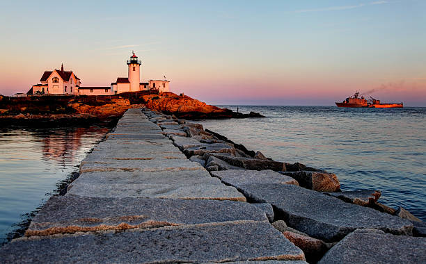 Eastern Point Lighthouse on the east side of the Gloucester Harbor Eastern Point Lighthouse is situated at the eastern tip of Massachusetts Gloucester Harbor.  The lighthouse is currently operated by the United States Coast Guard gloucester massachusetts stock pictures, royalty-free photos & images