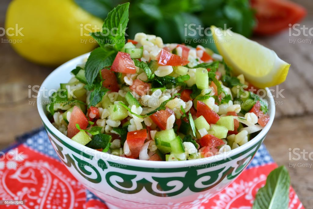 Eastern salad tabbouleh with bulgur, mint and parsley stock photo