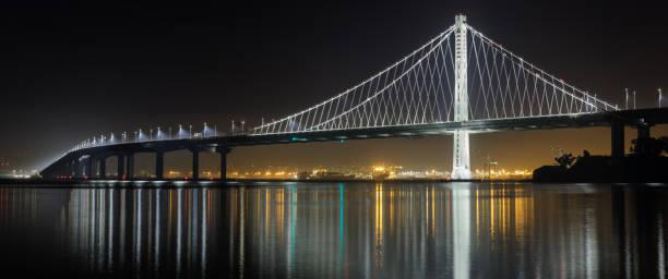 Eastern span of San-Francisco-Oakland Bay Bridge panoramic view at night stock photo