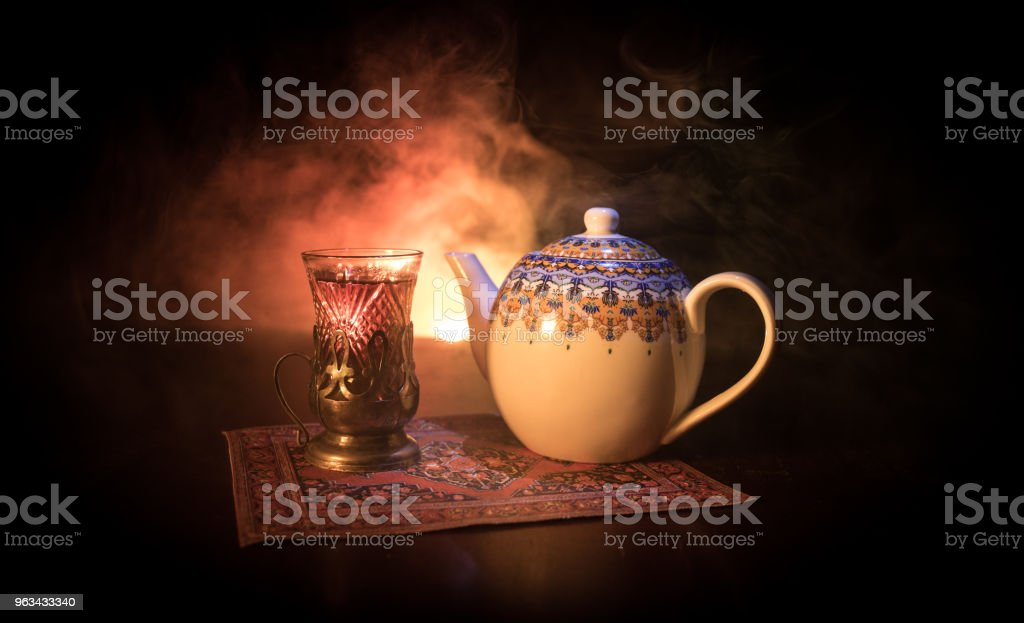 Eastern tea in traditional glasse and pot on black background with lights and smoke. Eastern tea concept. Armudu traditional Azerbaijan/Turkish cup - Zbiór zdjęć royalty-free (Azerbejdżan)