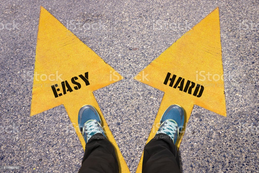 Easy and Hard painted on road stock photo