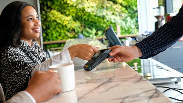 easy contactless card payment - paying with card contactless imagens e fotografias de stock