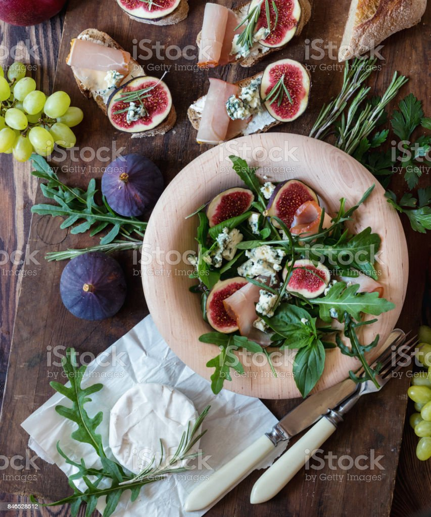 Easy diet salad with arugula, figs and blue cheese stock photo