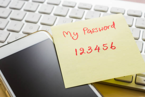 Easy number password note stick on smartphone, keyboard. stock photo