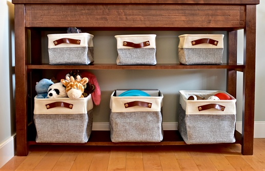 Home organization solutions of drawers and baskets in baby toddler rooms and living rooms for easy kid toy clean up and storage