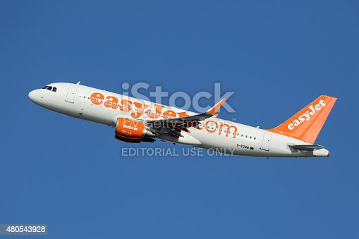 Barcelona, Spain - December 11, 2014: An easyJet Airbus A320 with the registration G-EZWW taking off from Barcelona Airport (BCN). EasyJet is a British low-cost airline with its headquarters near London and some 240 planes in operation.