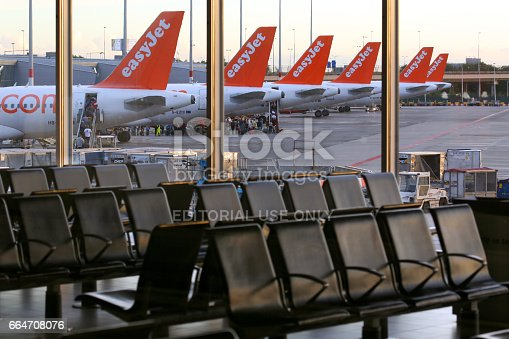 Amsterdam, Netherlands - July 6, 2014: EasyJet Airbus A320 tails at Schiphol airport, Netherlands