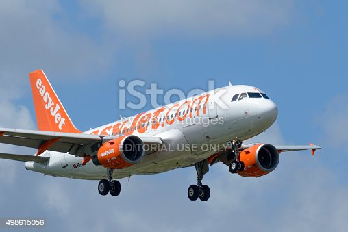 Schiphol, The Netherlands - June 22, 2014: EasyJet Airbus A319-111 landing at Amsterdam Airport Schiphol. The HB-JZP is part of the fleet of EasyJet Switzerland, a Swiss franchise of the British low-cost airline carrier easyJet.