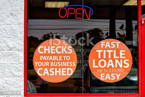Montgomery, USA - April 21, 2018: Easymoney payday loan financial institution with window sign for checks payable cashed, fast easy quick title loan in Alabama capital city