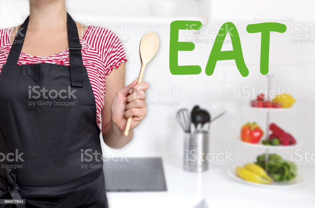 eat cook holding wooden spoon background concept stock photo