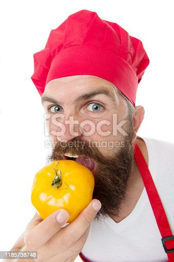 istock Eat fresh tomato. Tomato sauce recipe. Healthy cooking concept. Man with beard on white background. Chef holds tomatoes. Cook in uniform holds vegetables. Ripe tomato for delicious meal. Hungry man 1185738748
