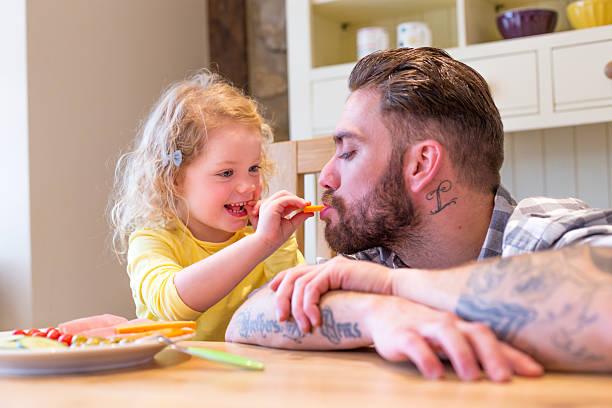 essen sie alle bis - essen tattoos stock-fotos und bilder