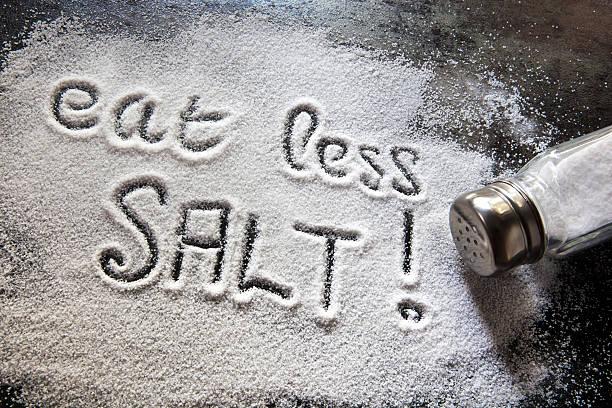 Eat Less Salt  salt stock pictures, royalty-free photos & images