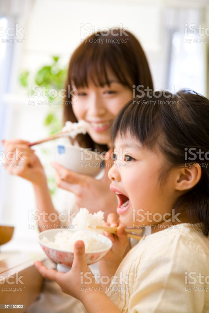 Eat the rice mother and daughter stock photo