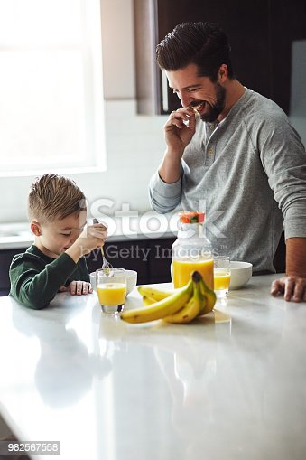 Cropped shot of a young boy and his father having breakfast in the kitchen