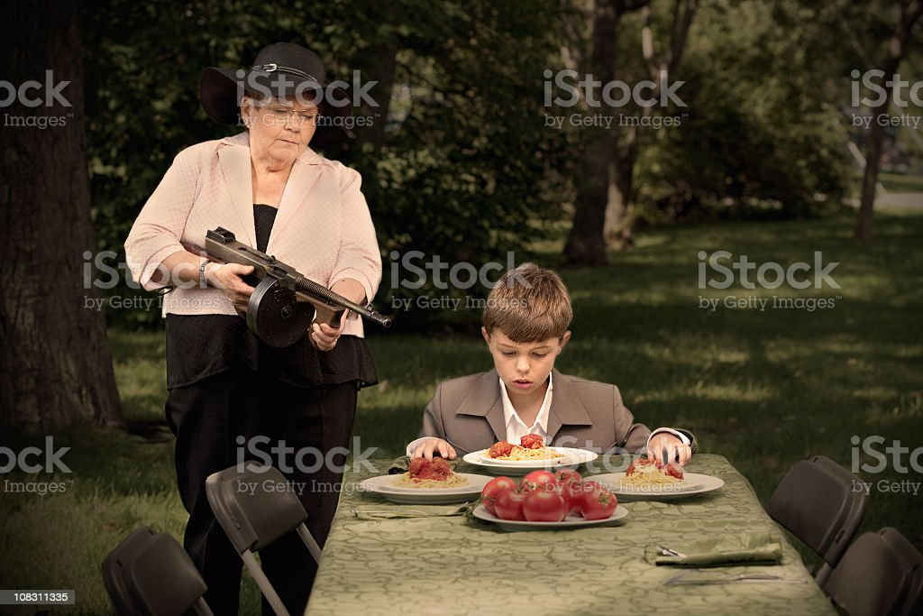 Eat up your food, buddy! stock photo