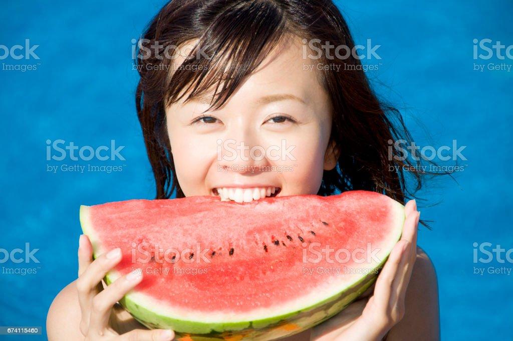 Eat watermelon swimsuit women royalty-free stock photo