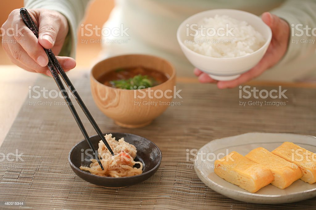 Eat with chopsticks stock photo