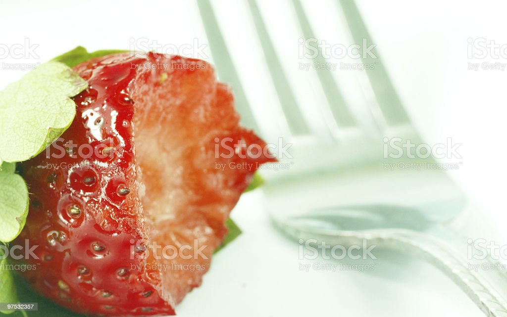 eaten strawberry with fork royalty-free stock photo