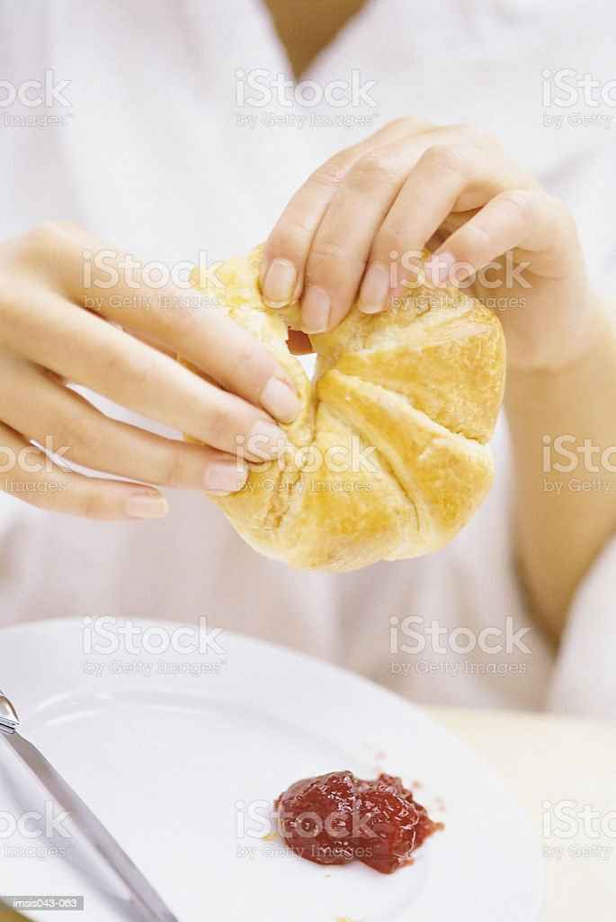 Eating a croissant royalty-free stock photo