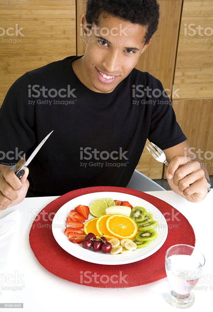 Eating a fruit salad royalty-free stock photo