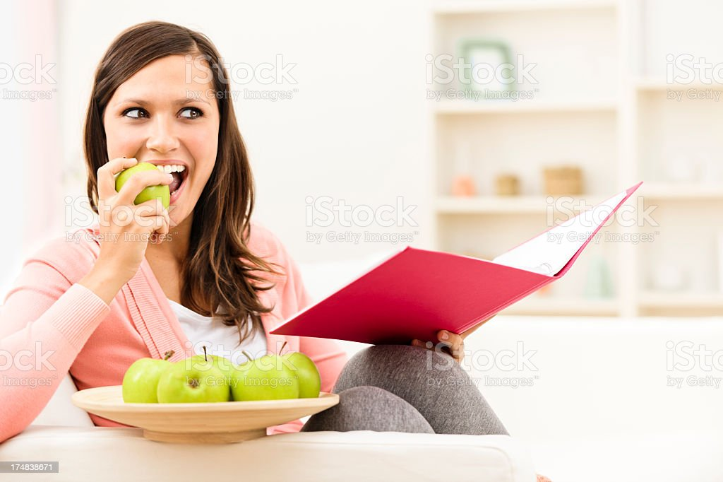 Eating a green apple royalty-free stock photo