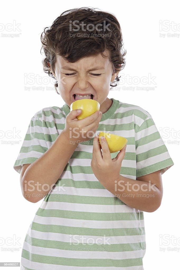 Eating a lemon royalty-free stock photo