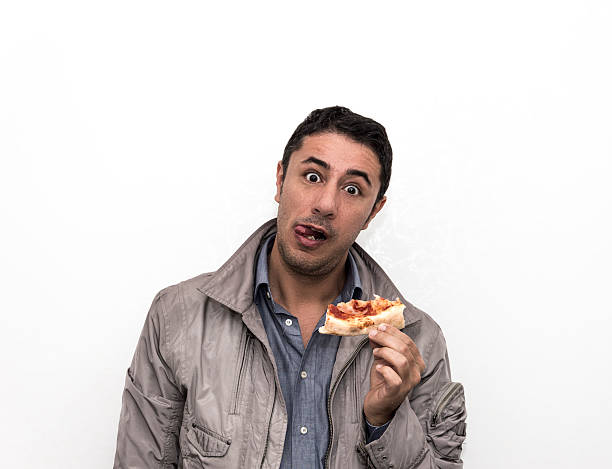 eating a pizza stock photo