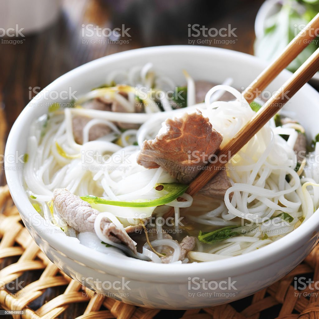 eating a steamy bowl of pho stock photo