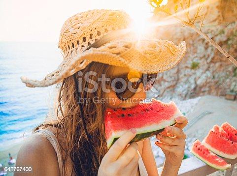 istock Eating and enjoying watermelon 642767400